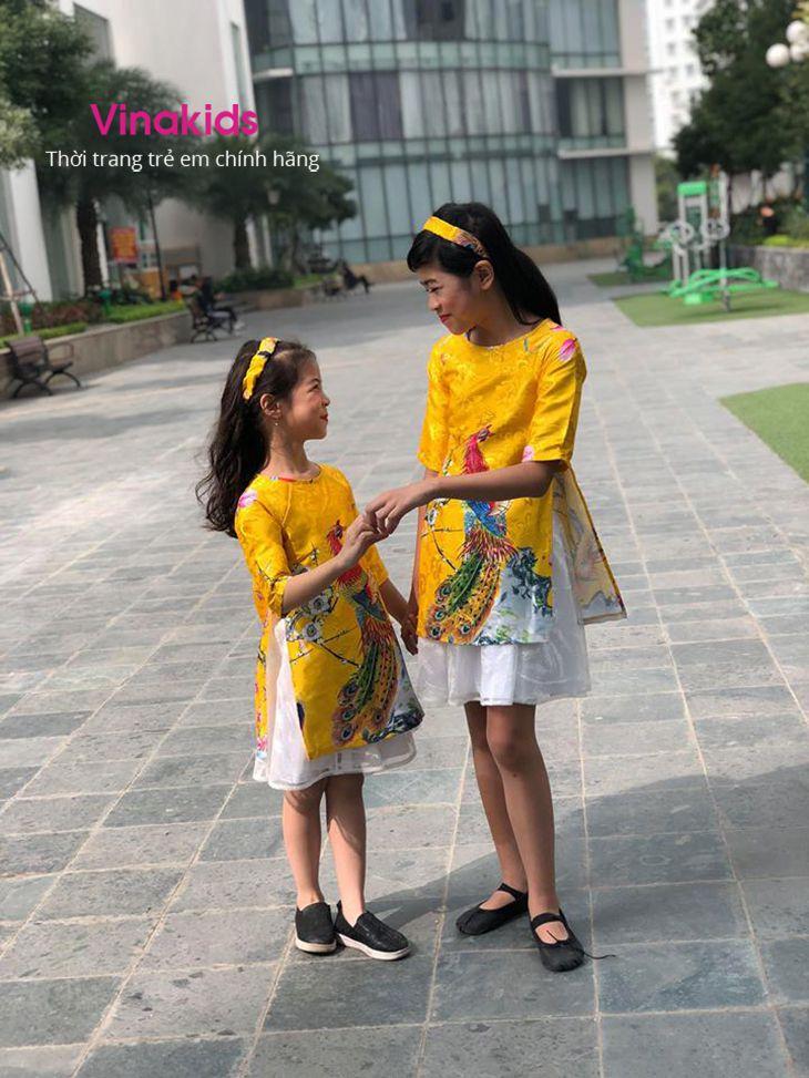 Sét áo dài cách tân bé gái hình công kèm tuban màu vàng (1-9 tuổi)