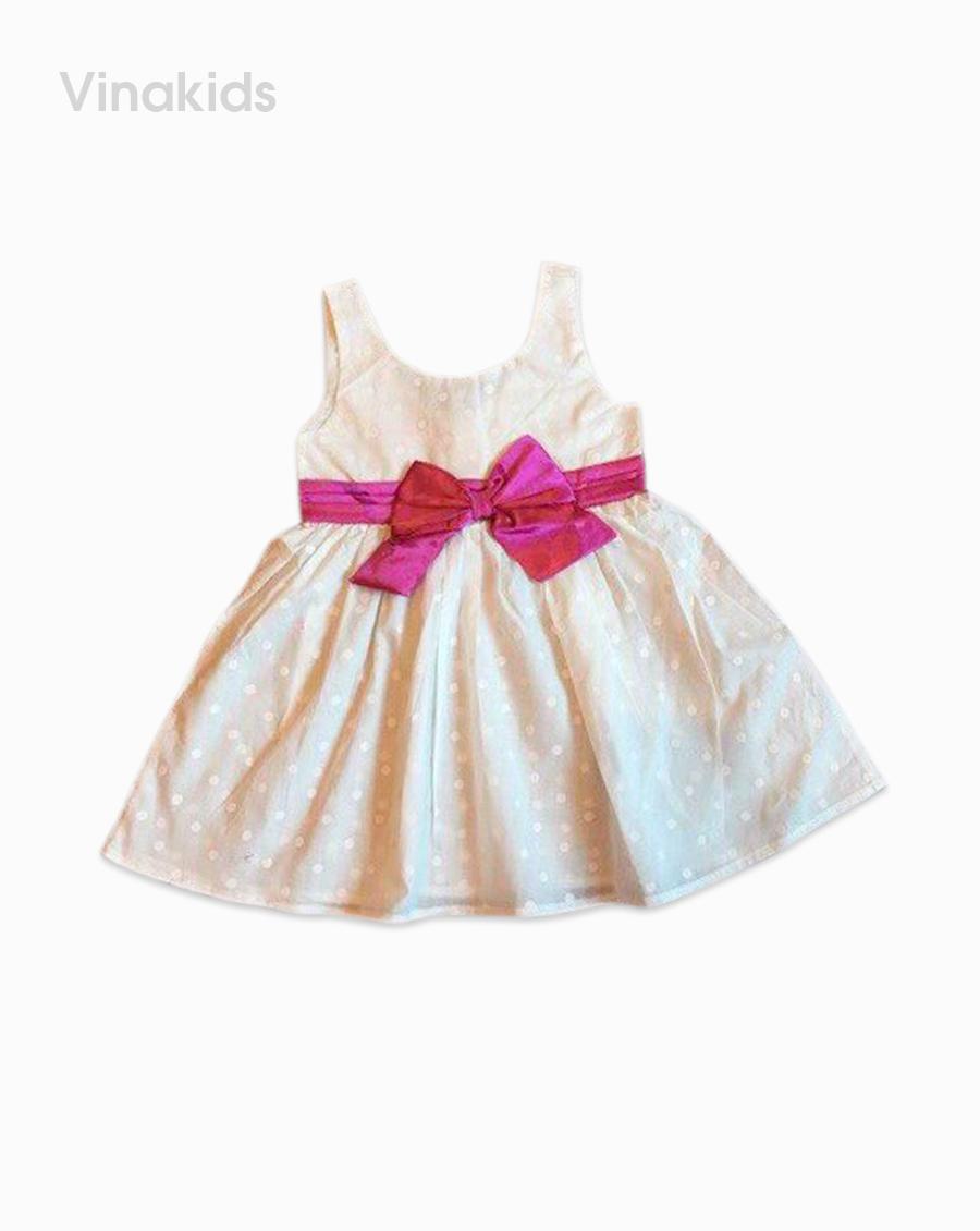 Váy bé gái chấm xếp ly eo màu trắng